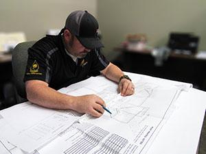 Aspen team member going over paperwork.
