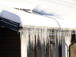 ice-sickles hanging off a roofing system