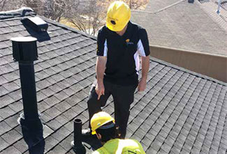 Project consultant performing services in the field, including inspecting a roof