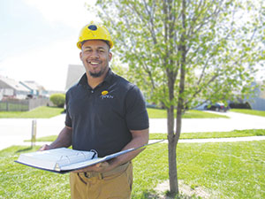 Example project consultant contractor in the field in uniform with work manual